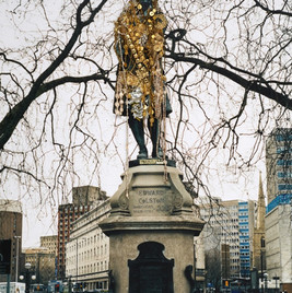 In 2006, the British artist Hew Locke covered the statue of Edward Colston in gold to exhibit the vast wealth Colston acquired from his active involvement in the slave trade.  Image courtesy of the Artist, Hales Gallery and P·P·O·W. © Hew Locke. All Rights Reserved, DACS 2021.
