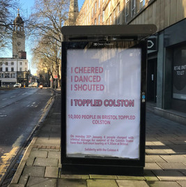 Bus stop advertisement replaced with Colston 4 solidarity messages.   Photo: Martin Booth, B24/7