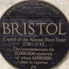 Will Coles attached an unauthorised heritage plaque to the statue's plinth in 2018.   Photo credit: Bristol 24/7