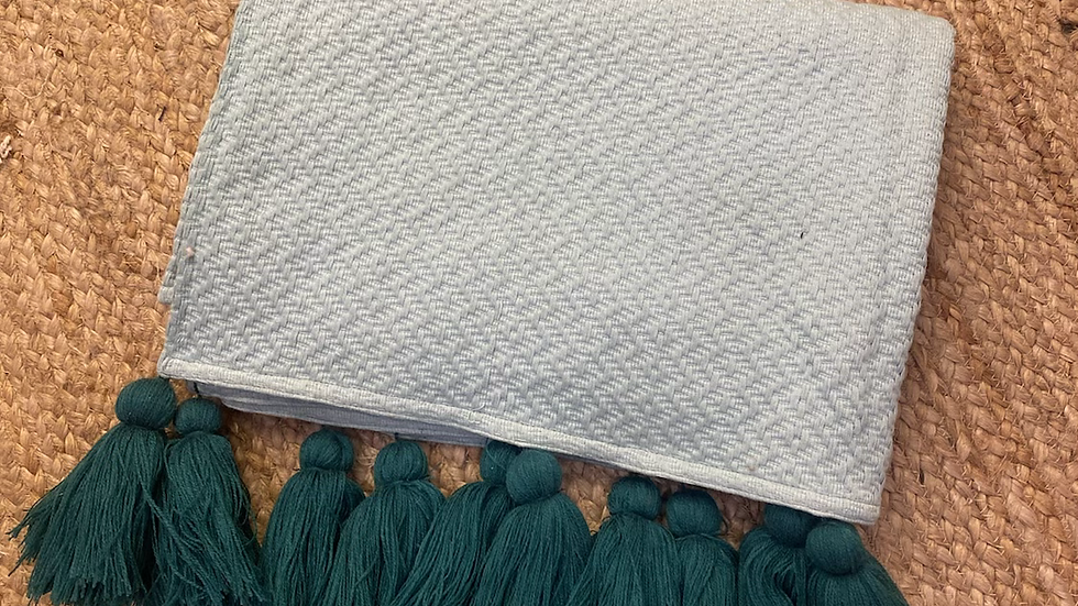Terquise throw with peacock tussels