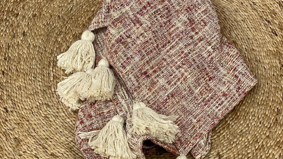 Slub textured throw with tassels