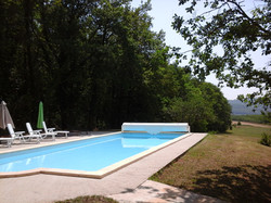 The pool terrace in the morning viewed from the shady terrace