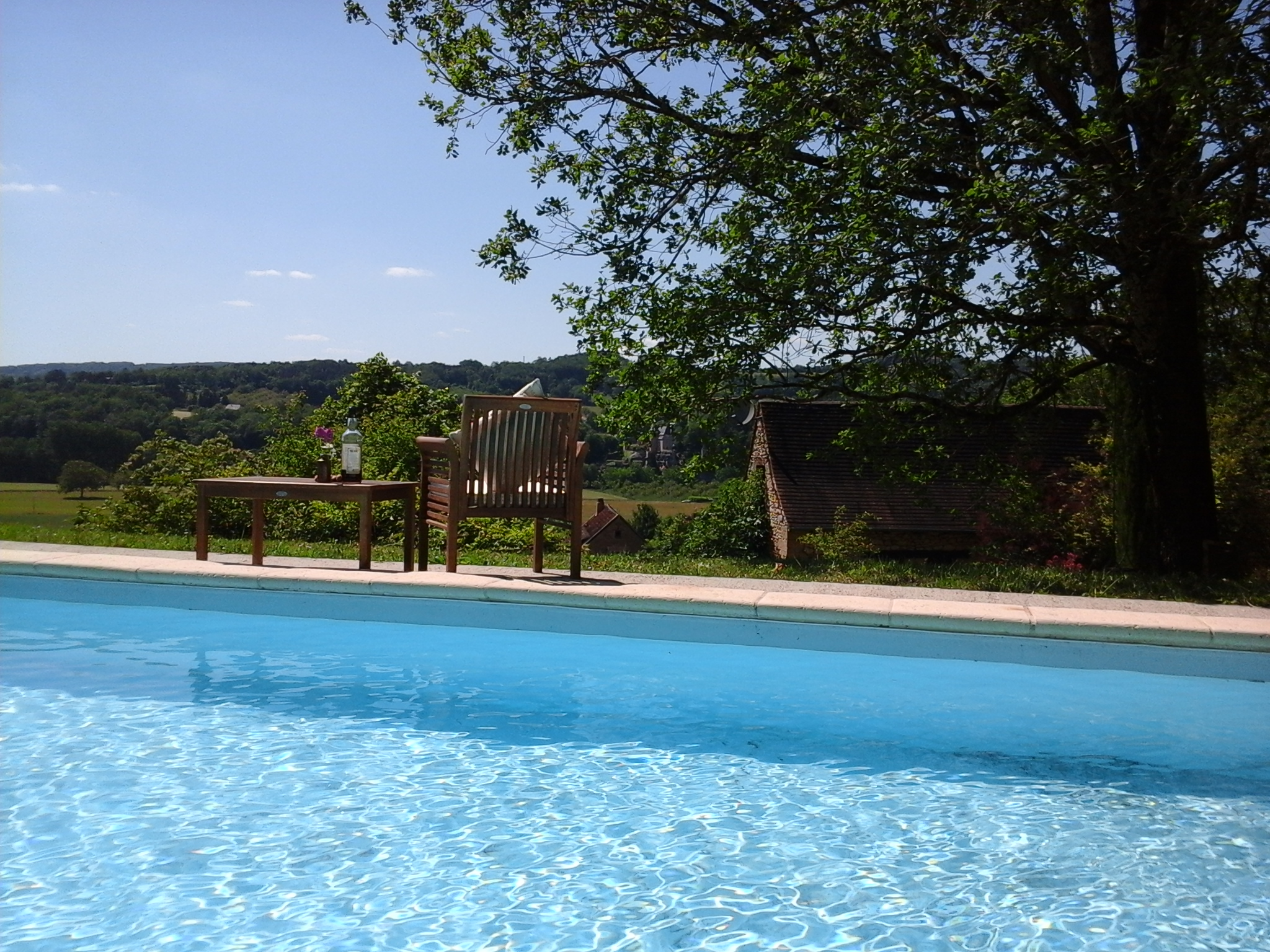 Relax by the pool with a wonderful view over the Vezere Valley and Chateau de Belcayre