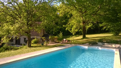 The pool, shady terrace and garden on a summers evening