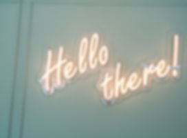 Neon glowing sign with word Hello there