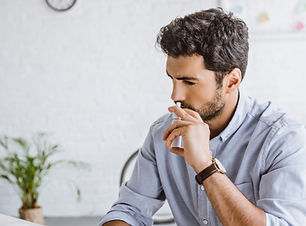 sick-manager-using-nasal-spray-in-office
