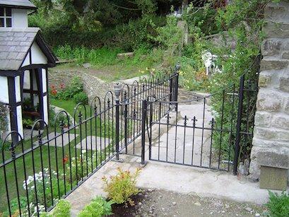Fleur de lis gate & railings.