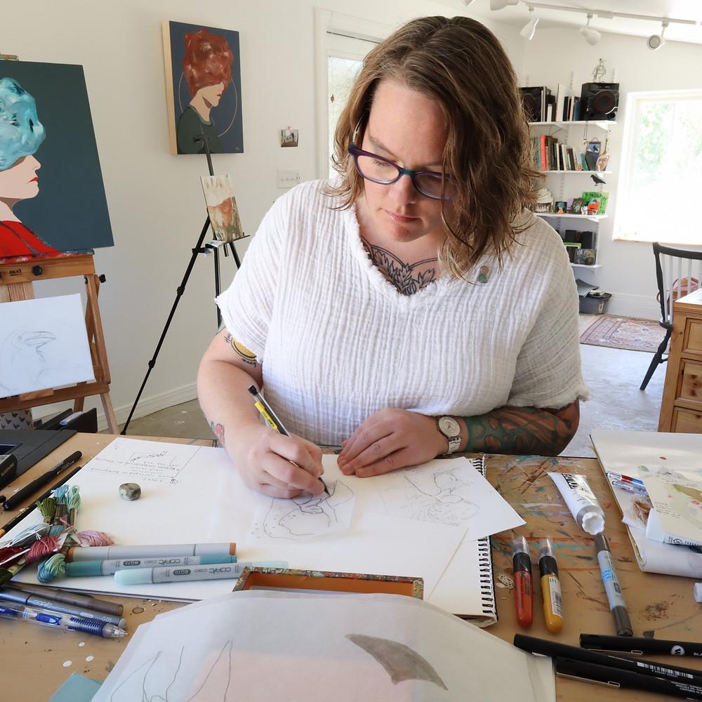 Raven Rohrig in her studio making portraits.