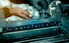 mechanic-technician-hand-fixing-industrial-machinery-in-factory-professional-technician-se