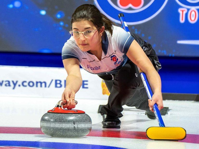 Deaf curler Emma Logan throws a curling rock