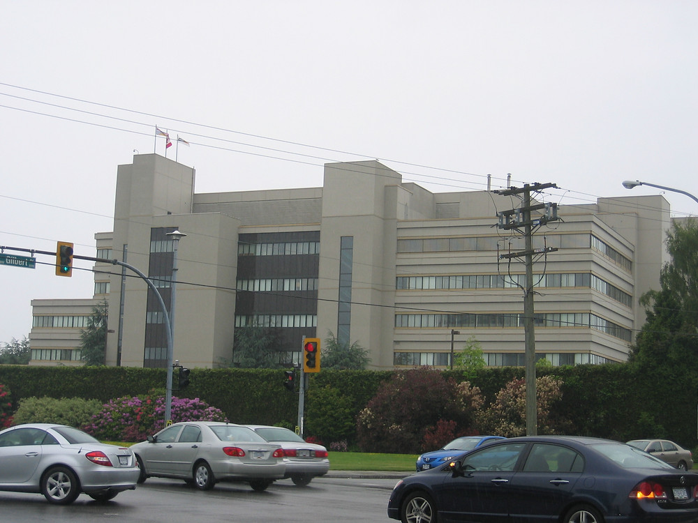 A photo of WorkSafe BC's headquarters, a large grey building.