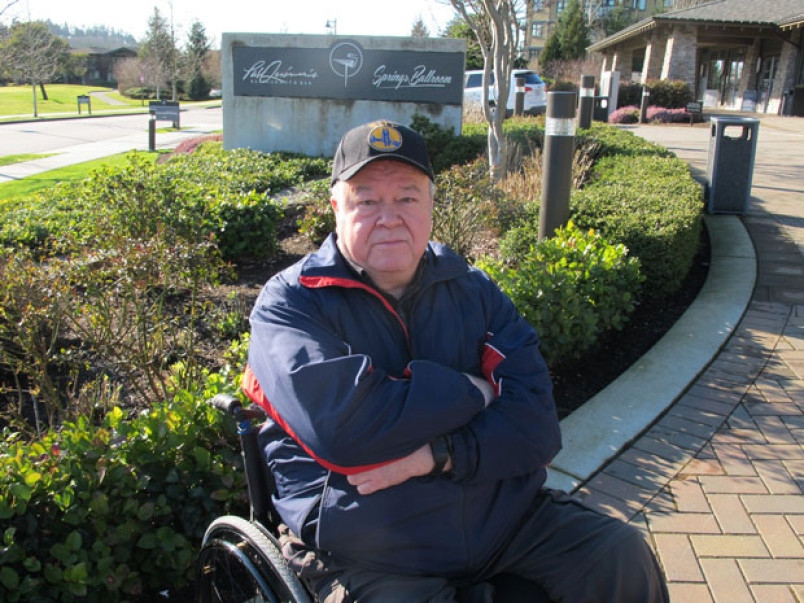 Disability advocate Vince Miele sitting in his wheelchair outside Pat Quinn's Restaurant and Bar