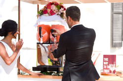 Groom pouring frosé from slush machine.
