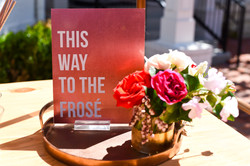 """Sign that reads """"This Way To The Frosé"""""""
