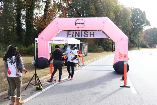 Participant and volunteer share a high five at the finish line  Covenant Pulmonary Critical Care Inaugural Breathe Easy 5K Run & Walk  Saturday - November 16, 2019  Photo: VISDECO