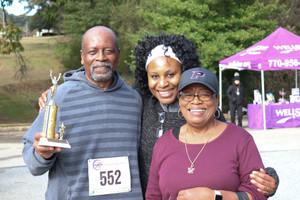 "Dr. Orjioke and the winner for the ""Walkers""  Covenant Pulmonary Critical Care Inaugural Breathe Easy 5K Run & Walk  Saturday - November 16, 2019  Photo: VISDECO"