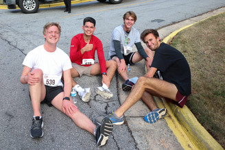 Runners resting near the finish line after completing the 5K run  Covenant Pulmonary Critical Care Inaugural Breathe Easy 5K Run & Walk  Saturday - November 16, 2019  Photo: VISDECO