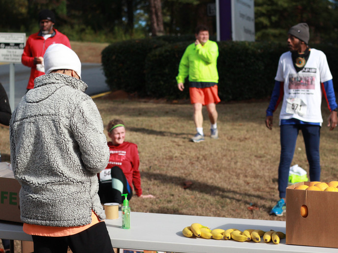 Volunteer handing out snacks at the finish line    Covenant Pulmonary Critical Care Inaugural Breathe Easy 5K Run & Walk  Saturday - November 16, 2019  Photo: VISDECO