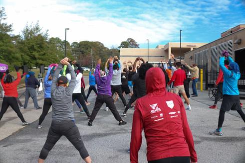 Participants warming up and stretching  Covenant Pulmonary Critical Care Inaugural Breathe Easy 5K Run & Walk  Saturday - November 16, 2019  Photo: VISDECO