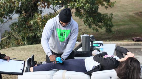Lance Dossie with Healing Thru Health using percussion massger on runner  Covenant Pulmonary Critical Care Inaugural Breathe Easy 5K Run & Walk  Saturday - November 16, 2019  Photo: VISDECO
