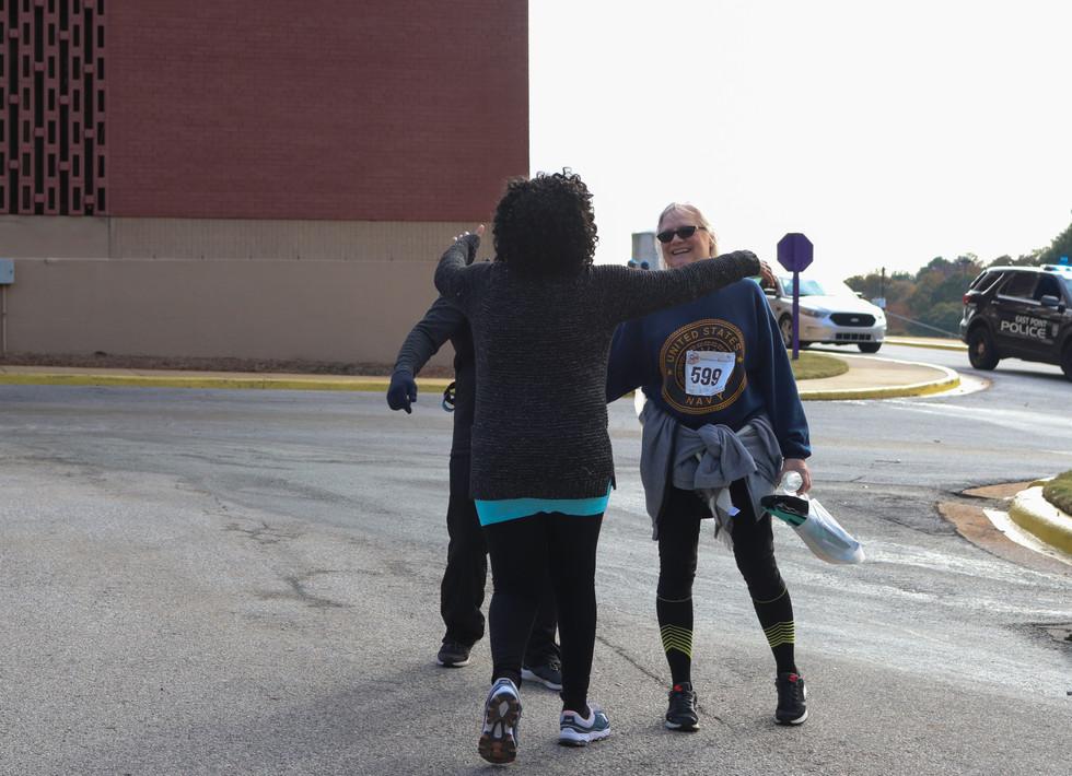 Dr. Orjioke hugging participants  Covenant Pulmonary Critical Care Inaugural Breathe Easy 5K Run & Walk  Saturday - November 16, 2019  Photo: VISDECO