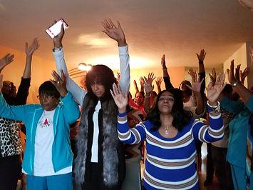 DOE Ladies - Raised Hands.jpg