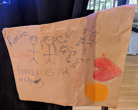 "Image description: Butcher paper titled ""Romeo,"" decorated by students with images and words describing Romeo as a character."