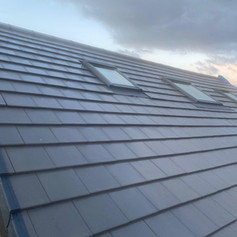 Roof completed with windows fitted