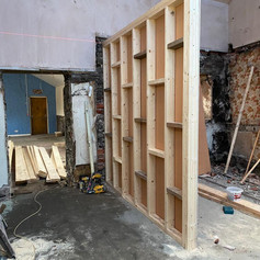 Wooden stud wall structure