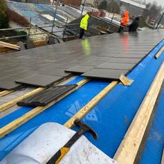 Roof tiling in progress