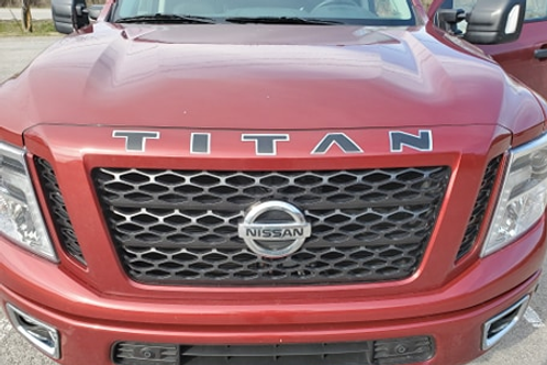 TWO-LAYER TITAN GRILL/HOOD LETTER INLAY