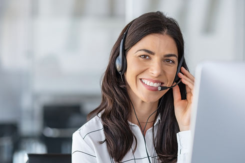 Call center agent with headset working o
