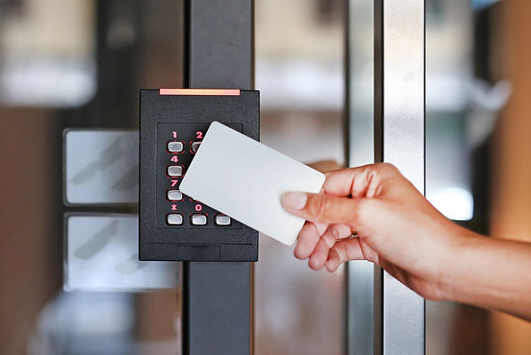 Door access control - young woman holdin