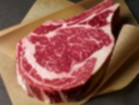 Raw ribey steak