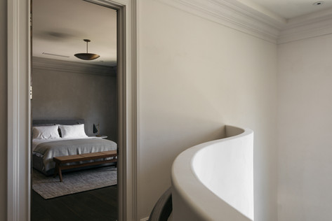 Curved Stair Wall to Bedroom 1.jpg