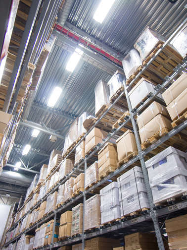 Rows of shelves with cardboard boxes on