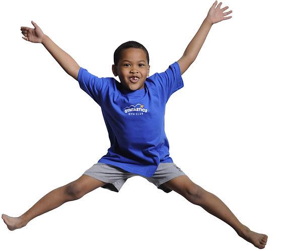 Yong boy gymnast doing a star jump