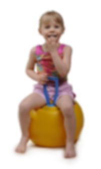Young girl on bouncy ball