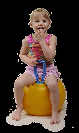 Young girl on bouncy ball
