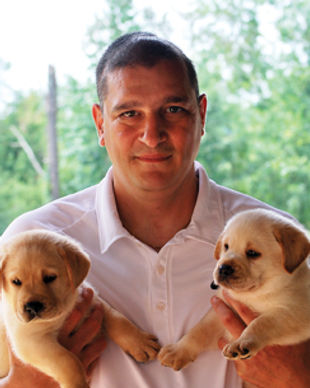Charlie with puppies.jpg