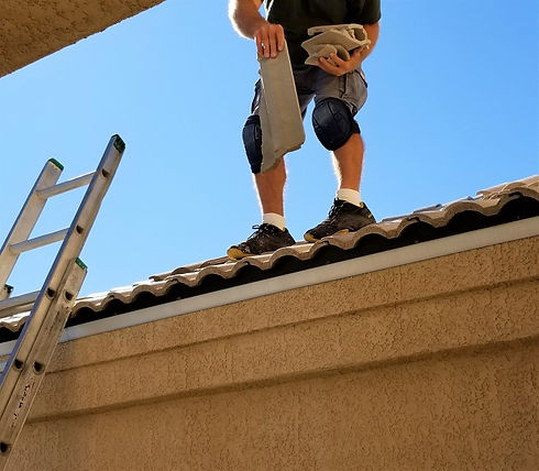 construction-roofer-laying-replacement-c