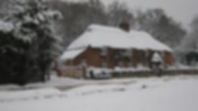 Picturesque view and image of the Thatched Cottage, North Weirs, Brockenhurst, in the snow
