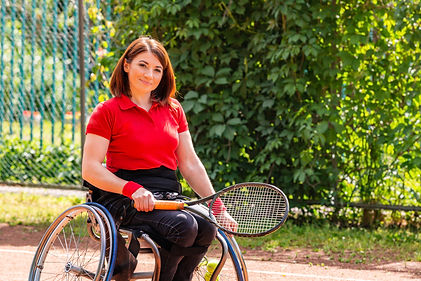 Women in a wheelchair playing tennis