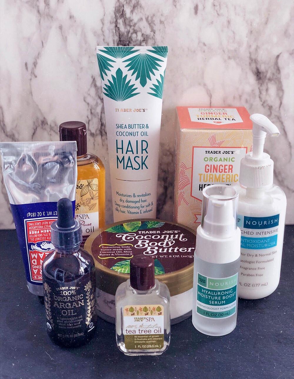 Trader Joe's Best Beauty Products hair mask, tea, facial moisturizer, serum, tea tree oil, body butter, organ oil, hand cream, jojoba oil