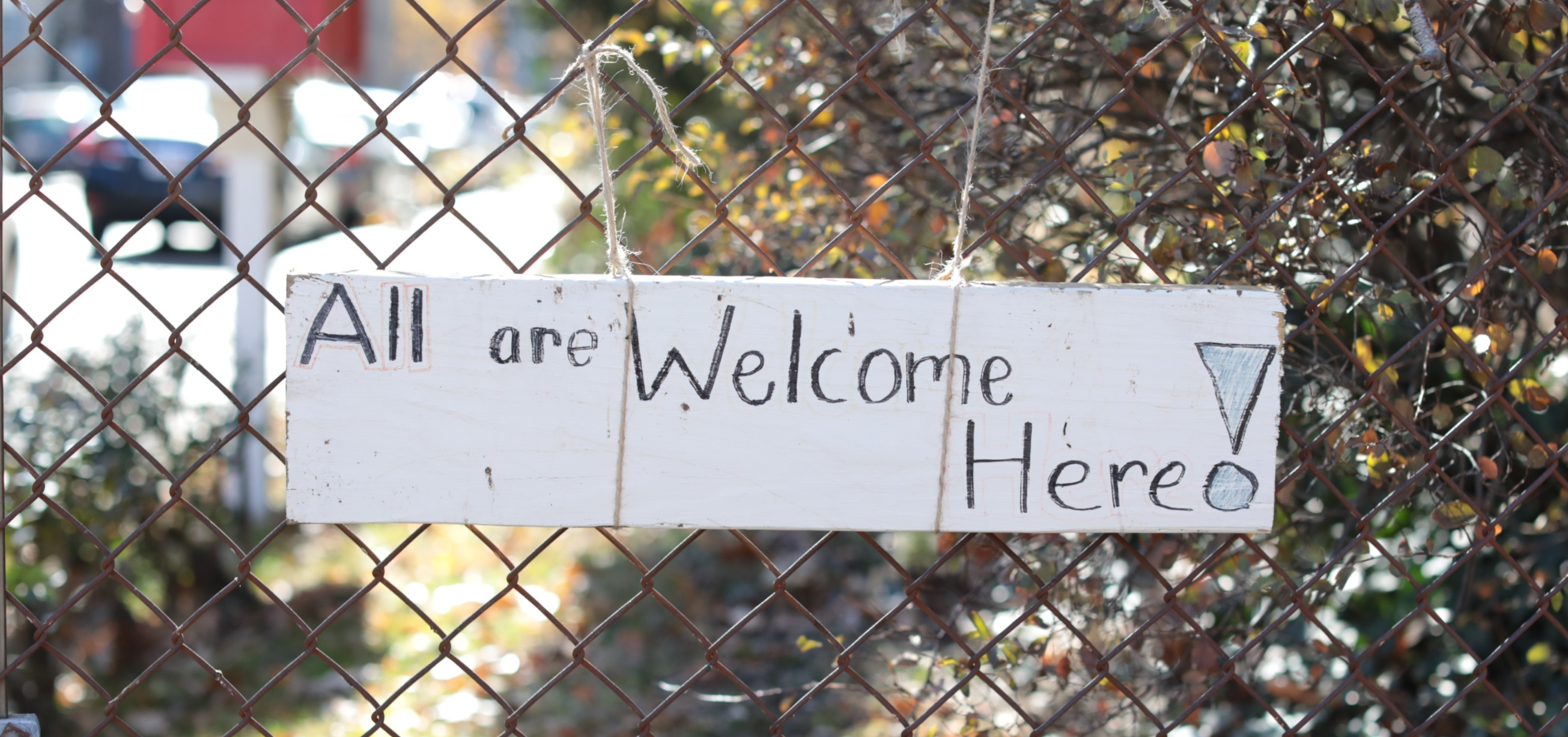 """All are Weclome Here!"" Sign posted to Creche community garden gate"