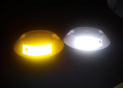 tachas reflectivas blanca y amarilla