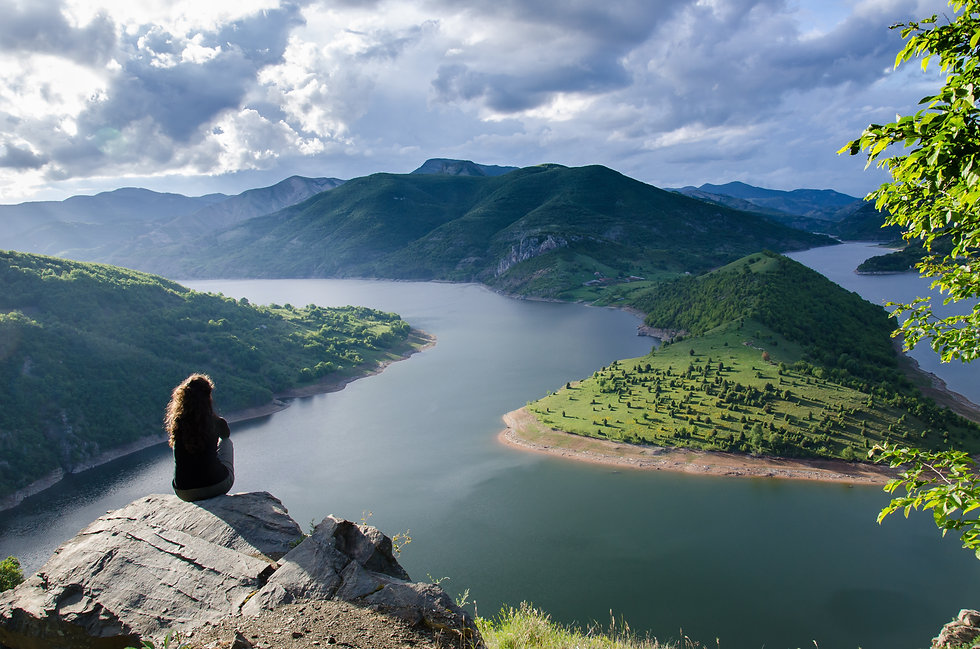 woman meditating relaxing alone Travel healthy Lifestyle concept lake and mountains sunny