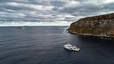 M/V Argo on anchor by Darwing Island.