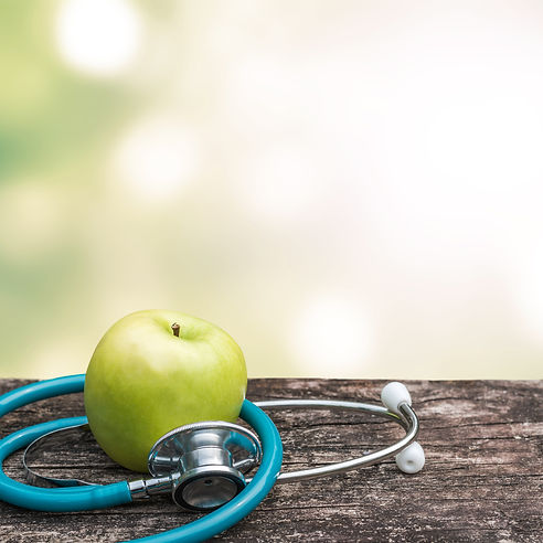 World health day concept with green natural nutrient apple with doctor's stethoscope .jpg