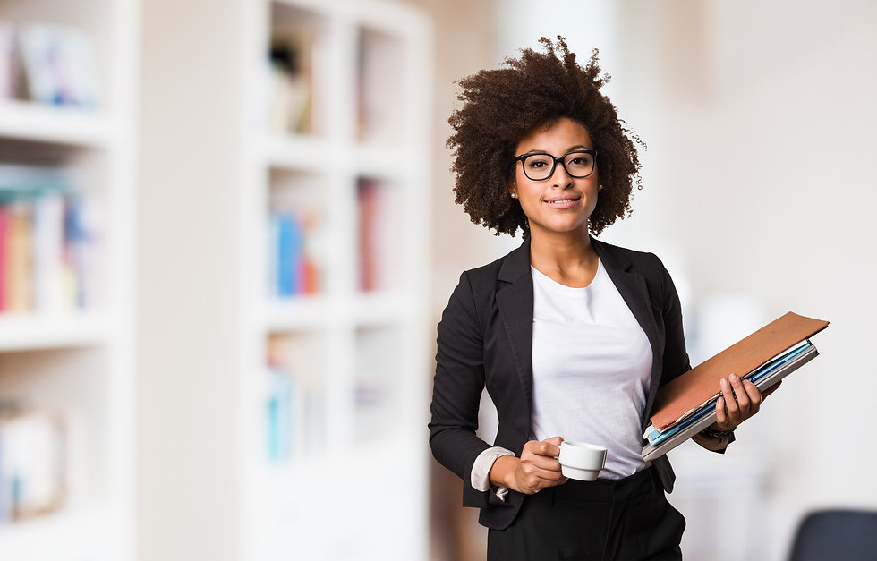 business black woman holding a cup of co